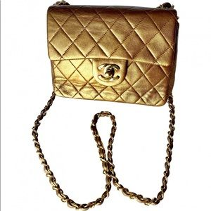 581f2d6aaab2 CHANEL. Chanel metallic bronze mini square Flap vintage